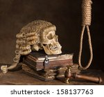 Small photo of Noose and judge's wig symbolizing death sentence