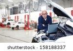 car mechanic checking engine.... | Shutterstock . vector #158188337