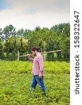 farmer walking through his...   Shutterstock . vector #158322647