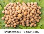 bunch of walnuts still fully in ...   Shutterstock . vector #158346587