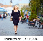 confident overweight woman... | Shutterstock . vector #158410607