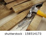 hammer and nails on wood | Shutterstock . vector #158514173