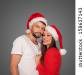 Loving Couple Wearing Santa...