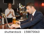 businessman having a beer while ... | Shutterstock . vector #158870063