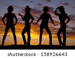 A Silhouette Of A Cowgirl In...