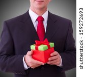 Businessman Holding Gift Box...