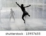 Boy Jumping In Water Fountain