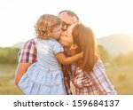dad mom and daughter kissing   Shutterstock . vector #159684137