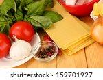 lasagna ingredients on wooden...