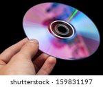 hand holding dvd over black... | Shutterstock . vector #159831197