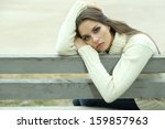 young lonely woman on bench in... | Shutterstock . vector #159857963