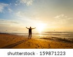 man with his hands up on the... | Shutterstock . vector #159871223