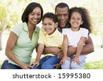 family sitting outdoors smiling | Shutterstock . vector #15995380