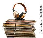 golden headphones lying on the... | Shutterstock . vector #160048487