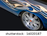 wheel and side of car with...