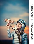 boy with a plane at sunset | Shutterstock . vector #160275083