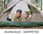 happy couple lying in tent... | Shutterstock . vector #160495703