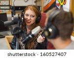 attractive happy radio host... | Shutterstock . vector #160527407
