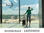 girl at the airport window  | Shutterstock . vector #160544033