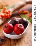 Small photo of azarole fruits in small white bowl on wooden table