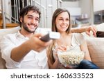 young couple preparing to watch ... | Shutterstock . vector #160633523