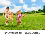 three happy kids chasing with... | Shutterstock . vector #160920863