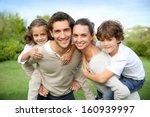 parents giving piggyback ride... | Shutterstock . vector #160939997