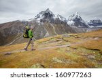 hiker on the trek in himalayas  ... | Shutterstock . vector #160977263