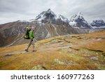 hiker on the trek in himalayas  ... | Shutterstock . vector #160977263