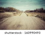 An Old Dirt Road Across The...