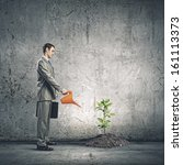 image of businessman watering... | Shutterstock . vector #161113373