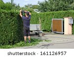 man is cutting a hedge | Shutterstock . vector #161126957