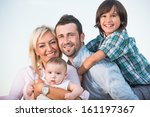 young parents with a smiling... | Shutterstock . vector #161197367