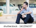 well dressed man smoking... | Shutterstock . vector #161206337