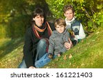 the father and two boys sit on... | Shutterstock . vector #161221403