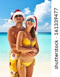 couple in santa's hat on a... | Shutterstock . vector #161339477