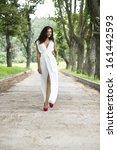 beautiful young woman walking... | Shutterstock . vector #161442593
