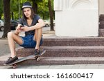 long haired handsome boy in a... | Shutterstock . vector #161600417