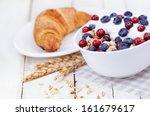 muesli with yogurt  and berri... | Shutterstock . vector #161679617