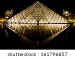 Musee Louvre In Paris By Night