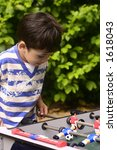 a young boy competing with his... | Shutterstock . vector #1618043