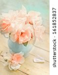Pink Roses In A Vase With Book...
