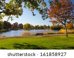 empty park bench by scenic lake ... | Shutterstock . vector #161858927