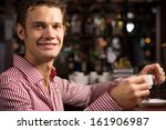man with a cup of coffee at the ... | Shutterstock . vector #161906987