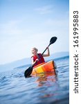 young woman kayaking alone on a ... | Shutterstock . vector #161995883