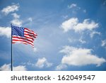American Flag On The Blue Sky