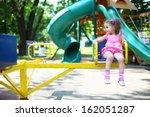 little girl in a pink dress on... | Shutterstock . vector #162051287