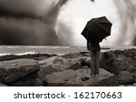 girl with umbrella on the ocean ... | Shutterstock . vector #162170663