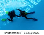 two divers are trained in the... | Shutterstock . vector #162198023