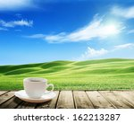 cup coffee and tuscany hills ... | Shutterstock . vector #162213287